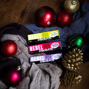 3 small bars of Rebel Chocolate with Christmas decorations